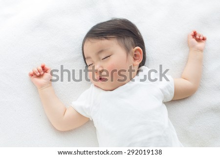 toddler taking nap time - stock photo