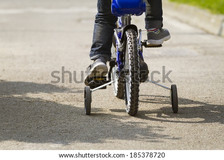Toddler Three year old tries out his new bike - stock photo
