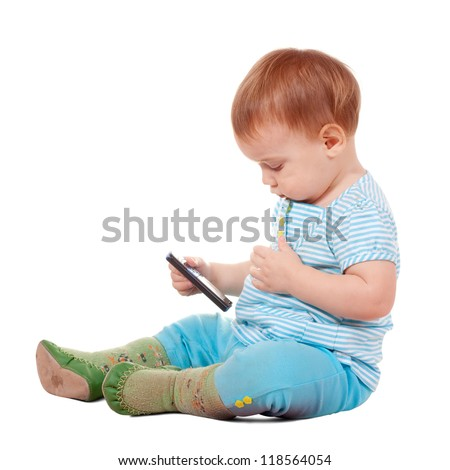 Toddler using mobile phone over white background - stock photo