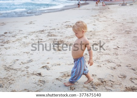 Toddler walking on a beach