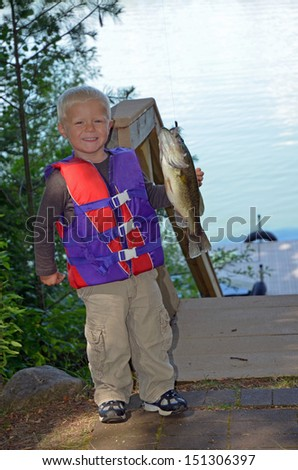 toddler with a large mouth bass