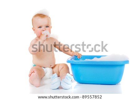 Toddler with soap foam on head - stock photo