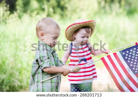 Toddlers having fun in the park for July Fourth.