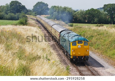 TODINGTON, UK - JULY 25: A preserved ex British Railways class 24 diesel locomotive takes passengers on pleasure trips during the GWSR summer diesel gala on July 25, 2014 in Todington - stock photo