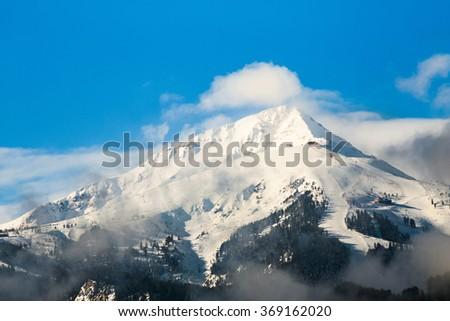 Todorka peak and Bansko ski resort in National park Pirin, Bulgaria. Bansko Ski slopes during the Alpine Skiing World Cup 2015. - stock photo