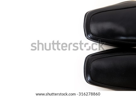 toe of a pair of black leather shoes  for men  with copy space isolated on white available with clipping path - stock photo