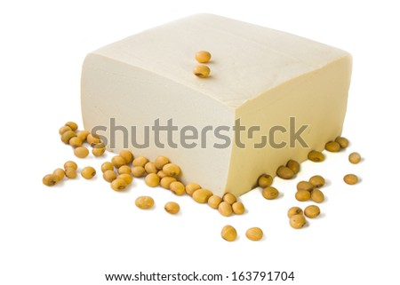 Tofu and soybeans. - stock photo