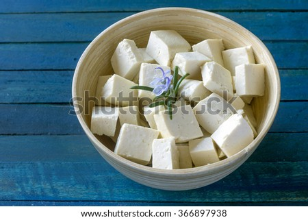 Tofu cubes in a wooden bowl  - stock photo