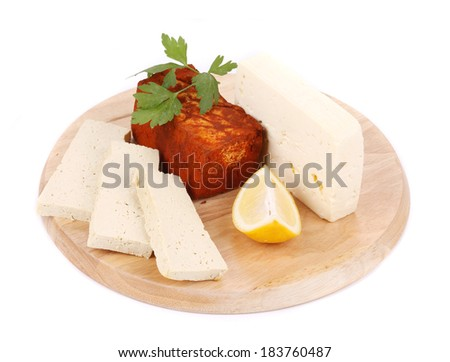 Tofu on a wooden table. Isolated on a white background.