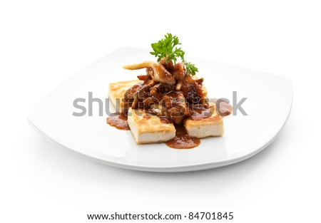 Tofu (Soy-bean Curd) with Mushrooms and Sauce - stock photo