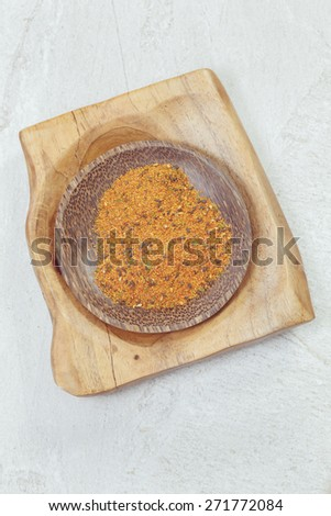 Togarashi, Japanese seven spice in a small bowl, overhead view with copy space. Macro photograph, selective focus