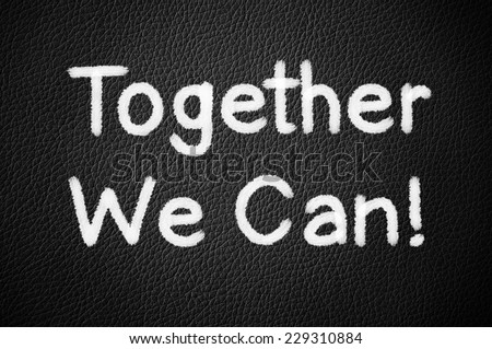 Together We Can ! written on a black leather background - stock photo