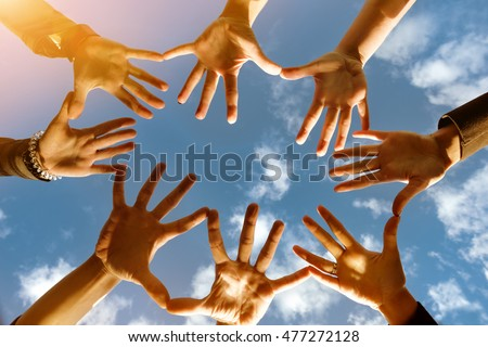 togetherness, team, union, people and gesture concept - close up of many hands over blue sky background