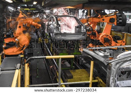 TOGLIATTI, RUSSIA - DECEMBER 06: Robots welding in a car factory. Welding car body of LADA Cars in Automobile Factory AVTOVAZ on December 06, 2013 in Togliatti