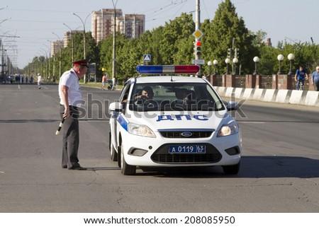 TOGLIATTI, RUSSIA - JUNE 1: Police patrol on the main avenue in the city of Togliatti on June 1, 2014 in Togliatti. - stock photo