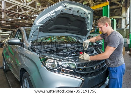 Togliatti, Russia - June 26: Preparation for the Start Of Product LADA XRAY Cars. Manual finishing. Automobile Factory AVTOVAZ - Member Alliance RENAULT-NISSAN-AVTOVAZ, on June 26, 2015 in Togliatti - stock photo