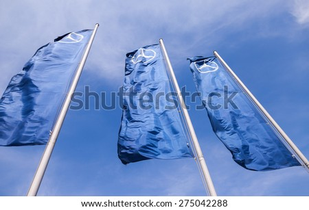TOGLIATTI, RUSSIA - MAY 3, 2015: The flags of Mercedes-Benz over blue sky.  Mercedes-Benz is a German automobile manufacturer - stock photo