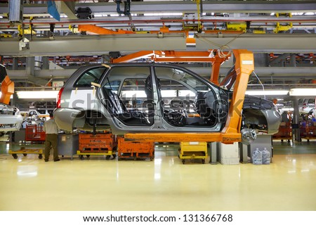 TOGLIATTI - SEPTEMBER 30: Body of passenger cars at Avtovaz factory on September 30, 2011 in Togliatti, Russia. In November 8, 2012 in Russia sold 100000th car LADA Granta. - stock photo