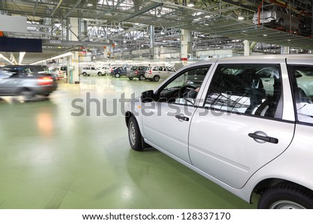 TOGLIATTI - SEPTEMBER 30: Lada Kalina cars go in hall on factory VAZ on September 30, 2011 in Togliatti, Russia. Lada Kalina safety rating Euro NCAP - Adults 8.4 out of 16. - stock photo