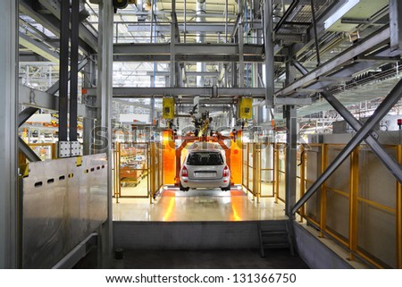 TOGLIATTI - SEPTEMBER 30: Passenger car hangs on assembly line at Avtovaz factory on September 30, 2011 in Togliatti, Russia. In 2013, Russia largest carmaker Avtovaz celebrating 47th birthday. - stock photo