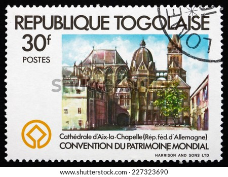 TOGO - CIRCA 1981: a stamp printed in Togo shows Aix-la-Chapelle Cathedral, Germany, World Heritage Year, circa 1981 - stock photo