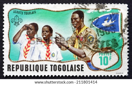 TOGO - CIRCA 1968: a stamp printed in Togo shows Scout Leader Training Cub Scouts, Togolese Boy Scouts, circa 1968 - stock photo