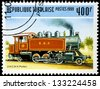 "TOGO - CIRCA 1999: A stamp printed in Togo shows the image of old railroad steam engine locomotive 2-6-2 (H.K. Porter), with the same inscription, from the series ""Old locomotives"", circa 1999 - stock photo"