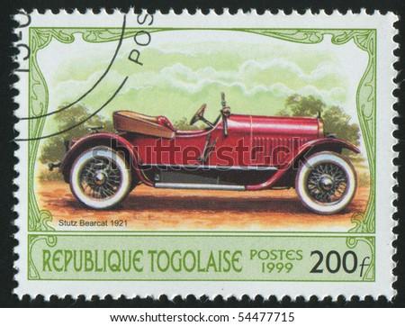 TOGO - CIRCA 1999: stamp printed by Togo, shows retro car, circa 1999. - stock photo