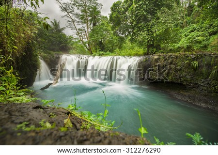 togotogiga waterfall samoa - stock photo