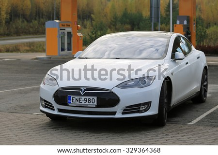 TOIJALA, FINLAND - OCTOBER 17, 2015: White Tesla Model S Electric Car parked near Tesla Supercharger. The current two Tesla Supercharger stations in Finland are located in Toijala and Paimio. - stock photo