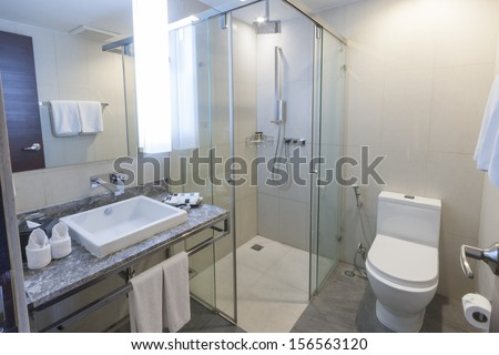 toilet and bathroom with rain shower head.