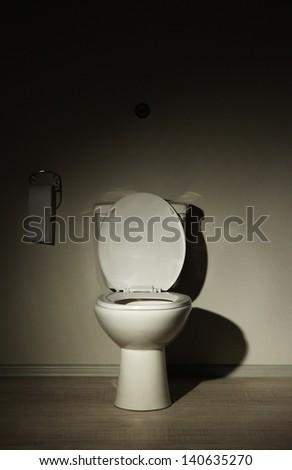Toilet bowl in a bathroom - stock photo