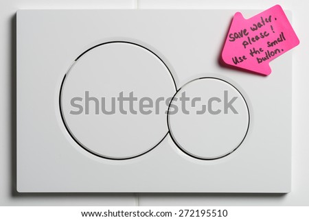 Toilet flushing buttons with pointing arrow reminding to save water - stock photo