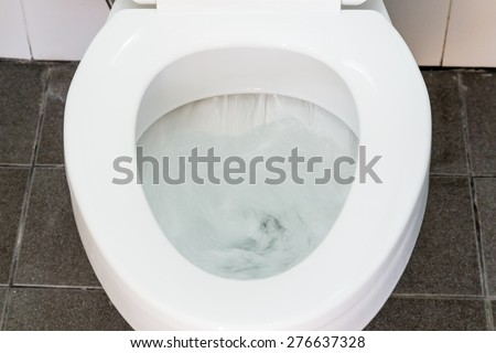 Toilet Flushing Water close up - stock photo