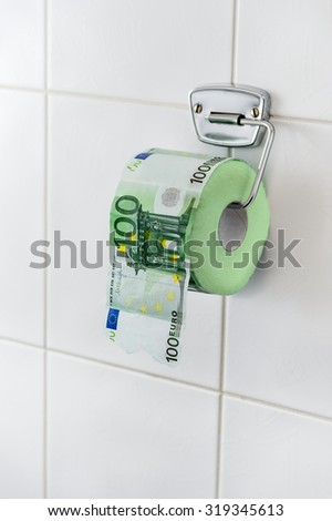 Toilet paper made of money - concept
