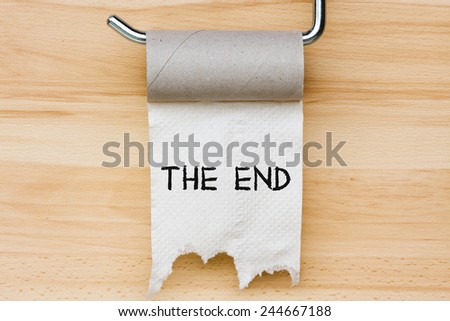 Toilet paper on wooden background - stock photo