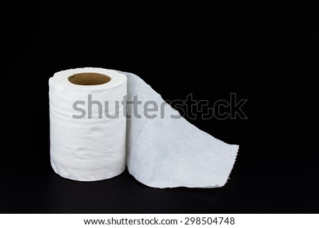 Toilet paper roll with black background - stock photo