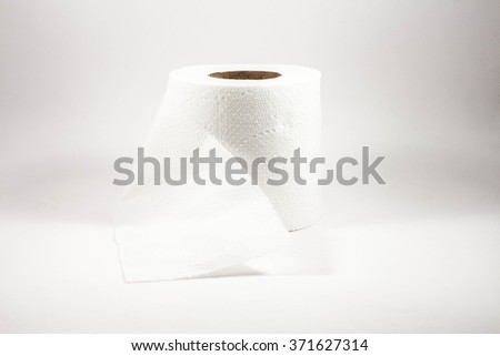 toilet paper wound into a roll on a white background - stock photo