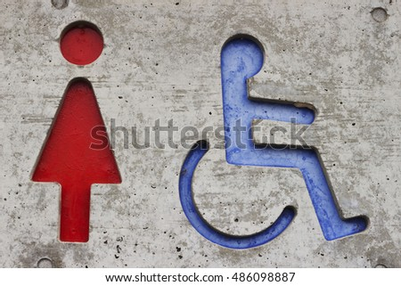 Toilet sign of women and people with disabilities   on concrete in park