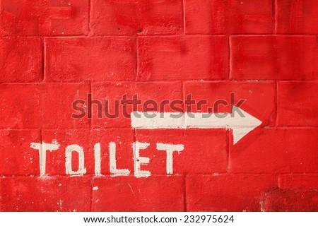 Toilet sign on vintage wall - stock photo