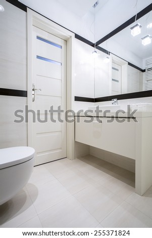 Toilet with washbasin in a modern apartment