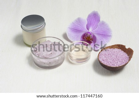 toiletries and pink orchid flower - stock photo