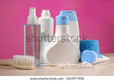 toiletries baby detail, blue items and pink background - stock photo