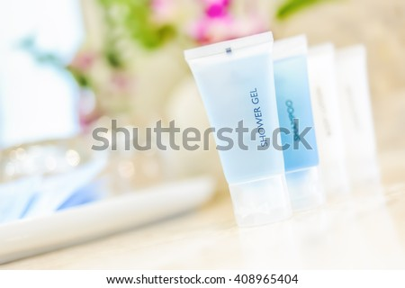 Toiletries tube in a luxury hotel, shower gel, shampoo, hair conditioner, body lotion. - stock photo