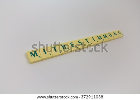 Tokens with text - headline, heading - council and the employer, terms in democratic workday, participation, democracy, discussion  - stock photo