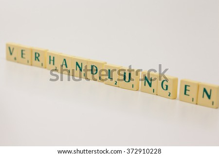 Tokens with text - headline, heading - negotiations, a part of everyday business life - stock photo