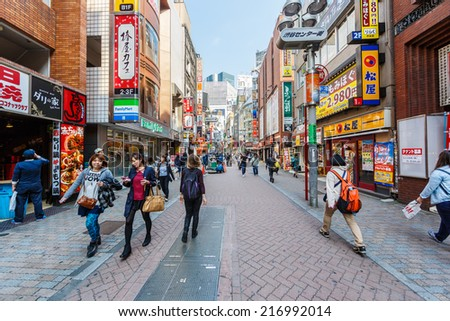 TOKYO - APR 10: People shop at Center Gai on Apr 10,14 in Shibuya. This area is known as one of the fashion centers of Japan, particularly for young people, and as a major nightlife area. - stock photo