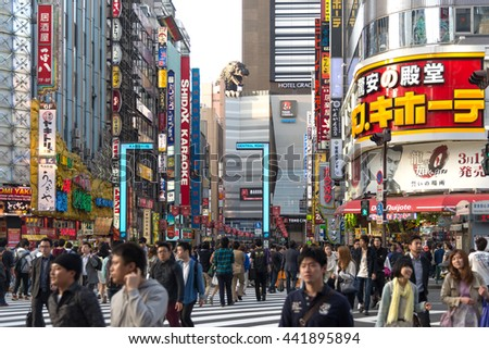 TOKYO - 26 APRIL 2015: Billboards in Shinjuku's Kabuki-cho district in Tokyo, Japan. The area is a nightlife district known as Sleepless Town. - stock photo