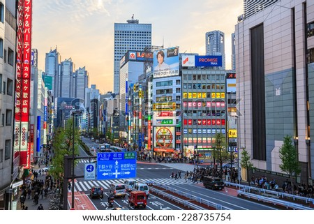 TOKYO - APRIL 12: City view of Shinjuku on April 12, 2014 in Shinjuku district, Tokyo. Shinjuku is one of the busiest districts of Tokyo, with many international corporate headquarters located here. - stock photo
