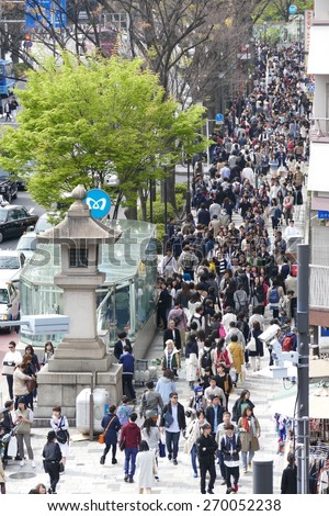 TOKYO - APRIL 11 2015: Crowds of people walking through Harajuku on Saturday April 11 2012. Harajuku is known internationally as a center of Japanese youth culture and fashion. - stock photo